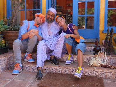 Blippi, Baba the Storyteller and Meekah sharing a group hug